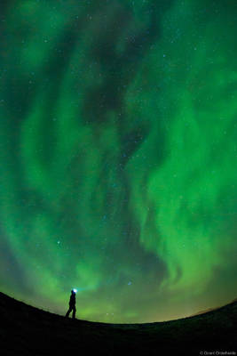 aurora, gazing, Grundarfjörður, Iceland, young, woman, admires, dancing, northern, lights, above