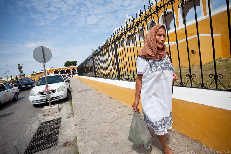izamal, yucatan, mexico, woman, walks, sidewalk, yellow, city