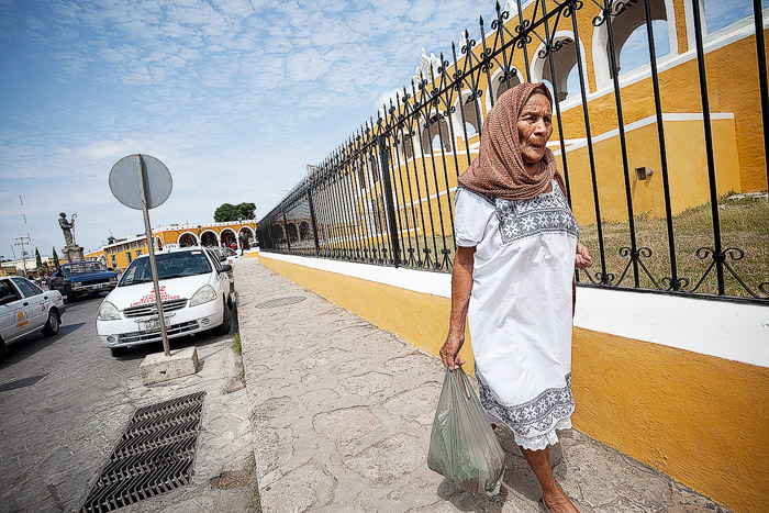 izamal, yucatan, mexico, woman, walks, sidewalk, yellow, city, photo