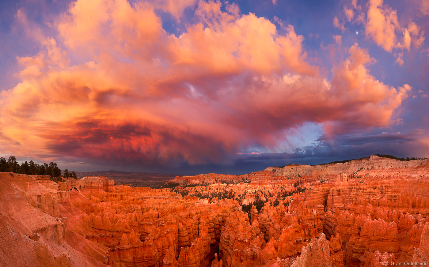 A dramatic storm cloud builds over the hoodoos of Bryce Canyon National Park.