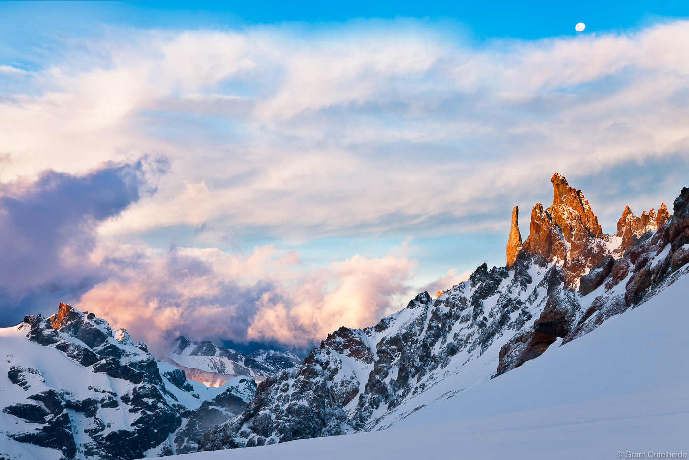 Sunset on some spires along the Peñon Glacier in Cerro Castillo National Reserve.