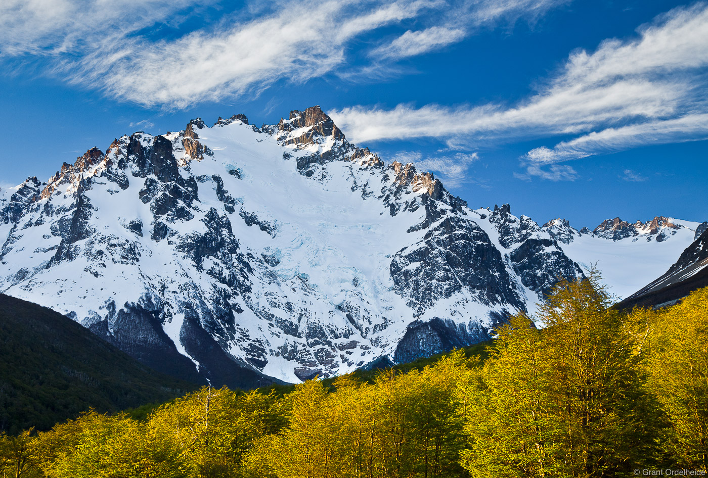Cerro Peñon, the second tallest peak in the Cerro Castillo National reserve, stands tall above spring lenga trees.