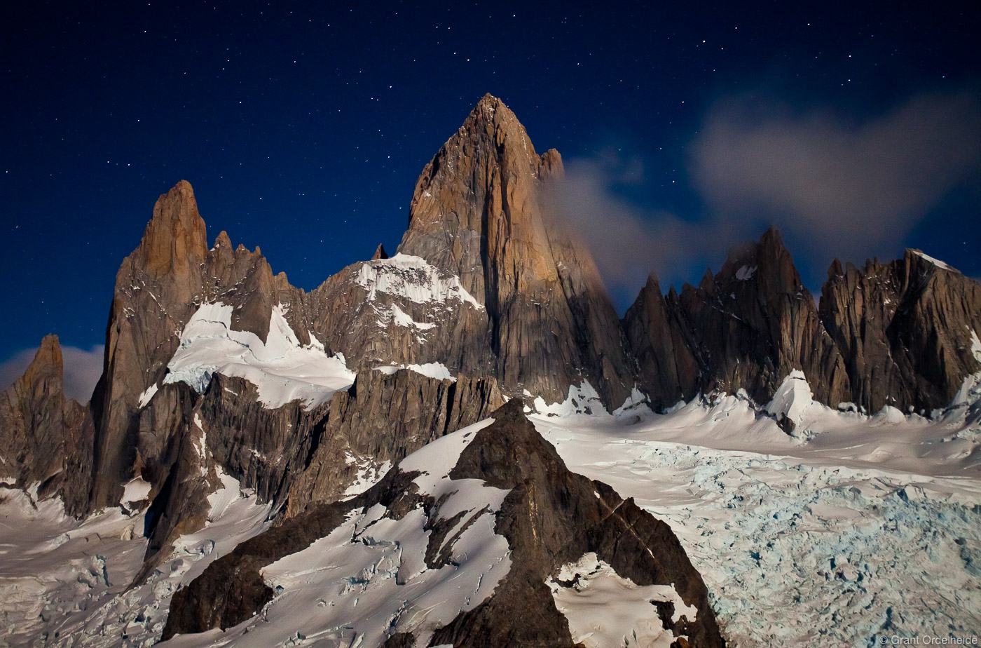 Moonlight illuminates Mount Fitzroy from the summit of Cerro Madsen.