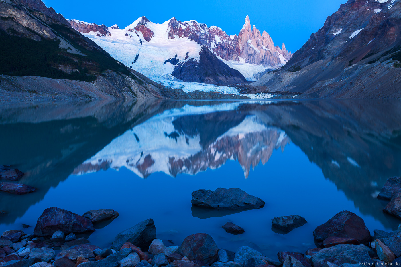 A rare windless morning on Laguna Torre with Cerro Torre towering above.