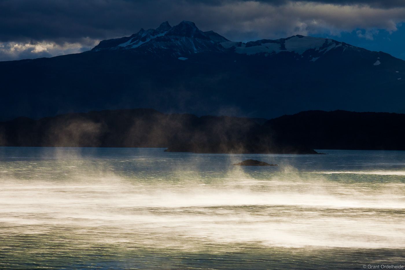 Massive walls of water being blown across the surface of Lago Nordenskjold in Torres del Paine National Park.