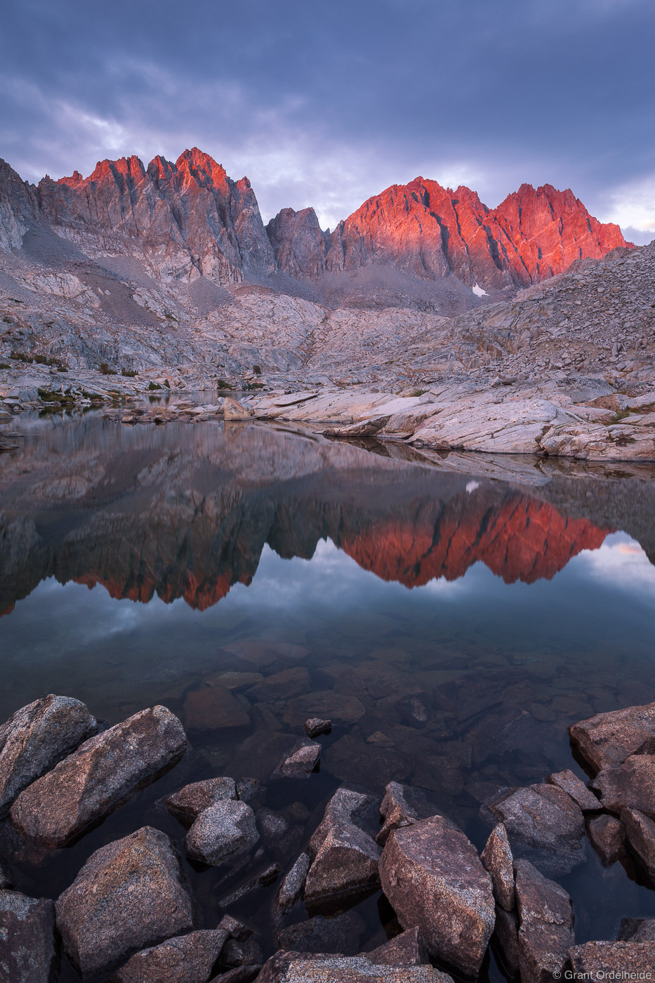 Sunset on the Palisade mountains reflected in an Dusy Basinalpine lake high in California's Kings Canyon National Park.