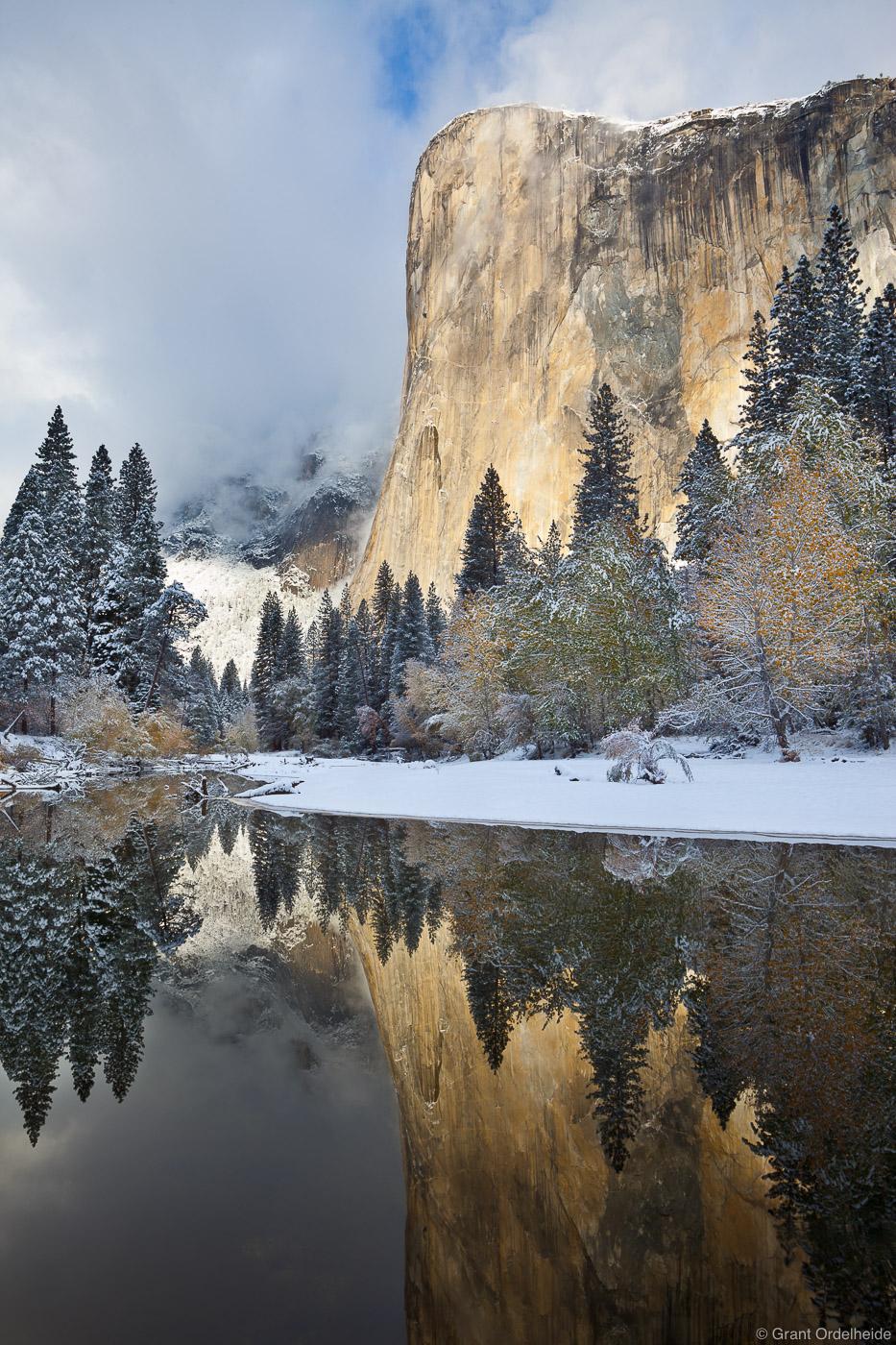 El Capitan refleced in the Merced river after a fall snowstorm.
