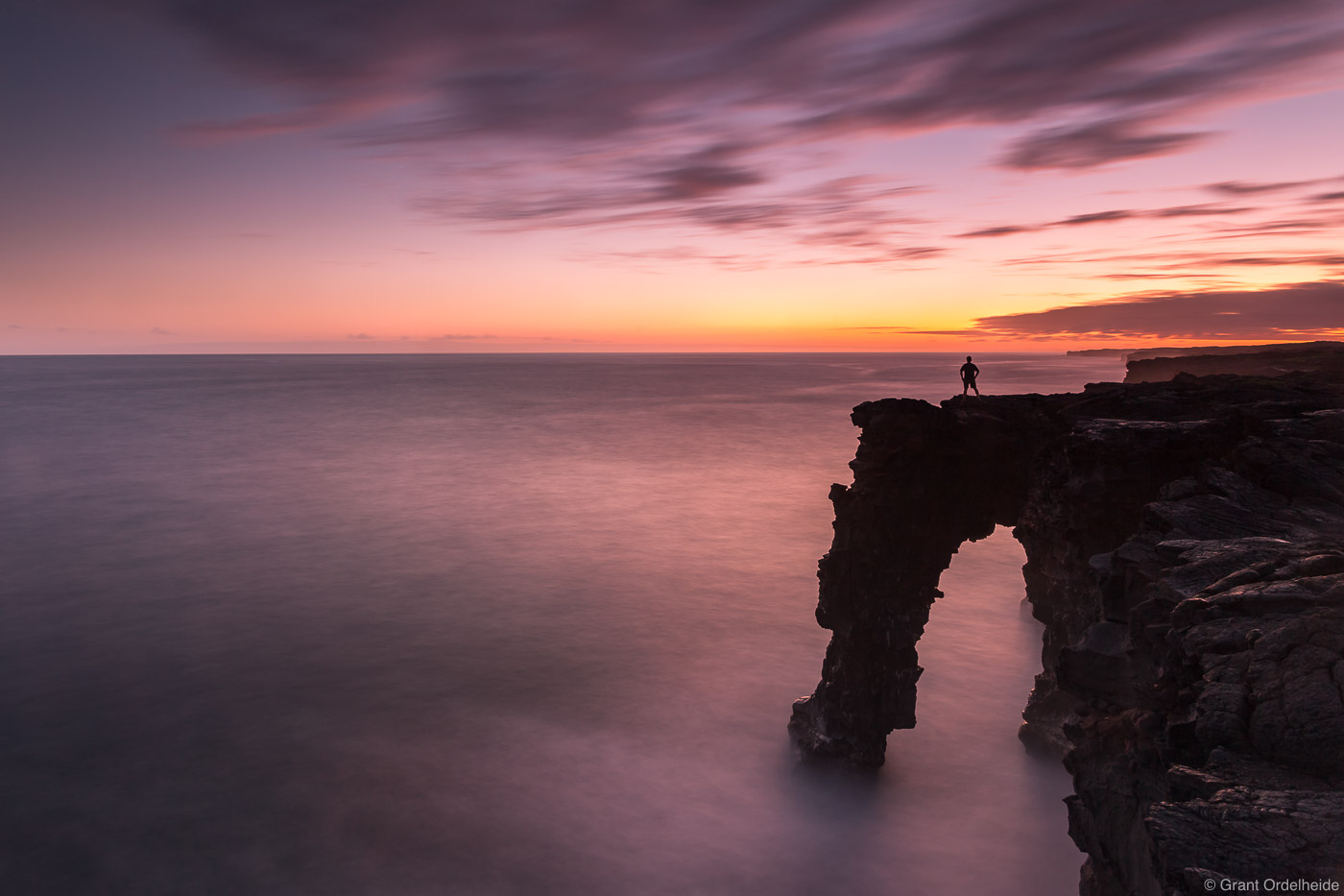 Sunset over theHolei Sea Arch in Hawaii Volcanoes National Park.