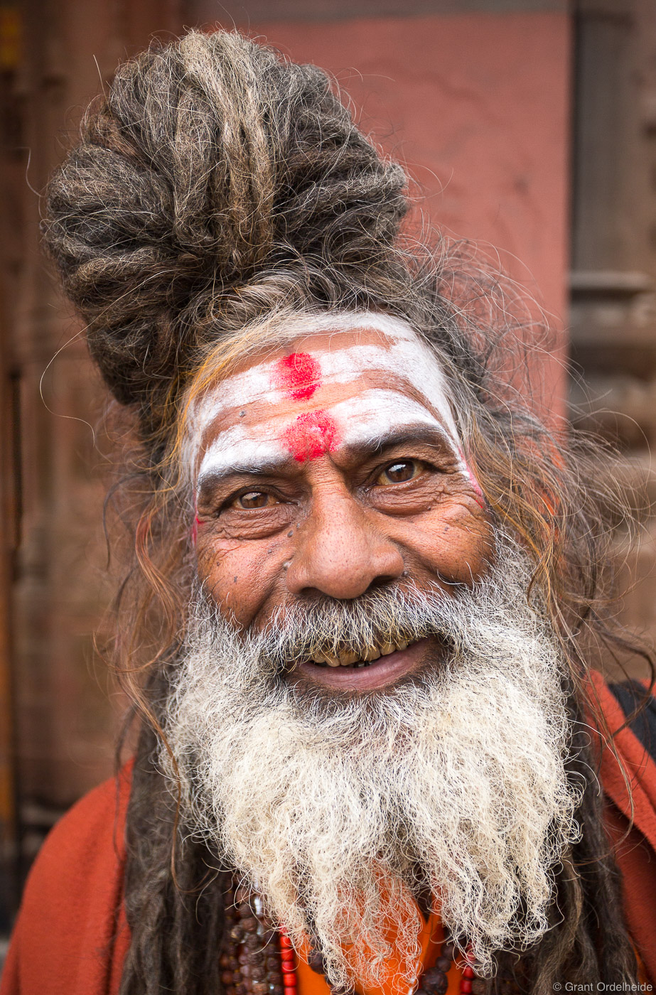A portrait of a holy man along the banks of the holy Ganges River.