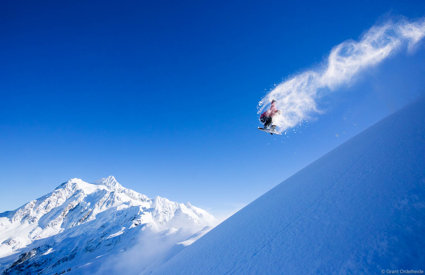 mt. shuksan, backside, one-eighty, snowboarder, baker, washington, grab, method, natural, wind, lip, feature, photo