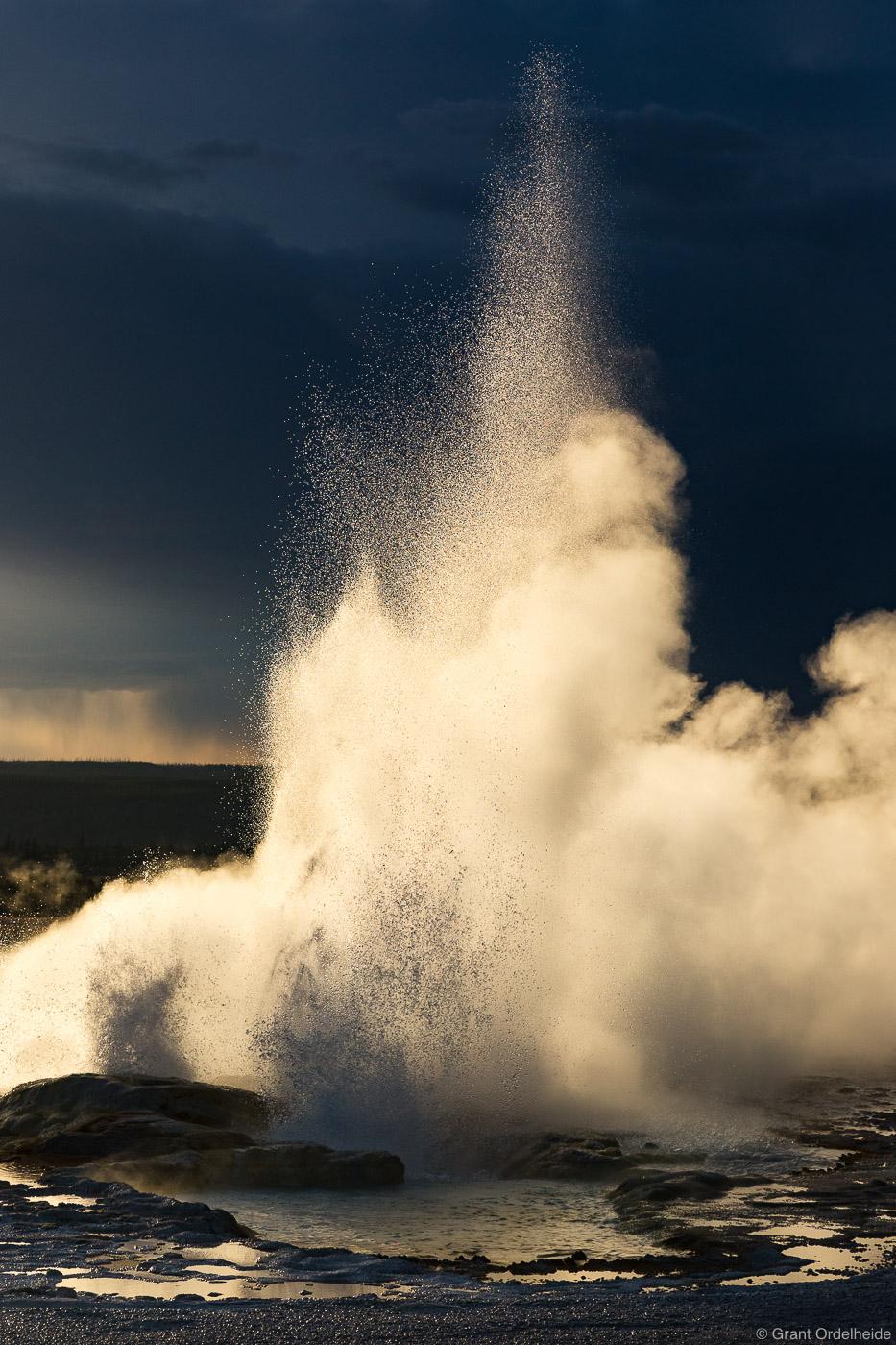 Clepsydra Geyser erupting below an impending summer storm.