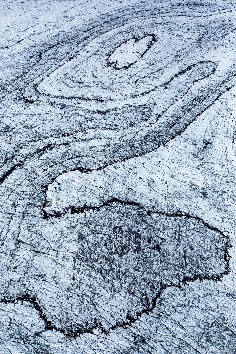 Aerial image of abstract lines and patterns in the Vatnajökull glacier in Iceland.