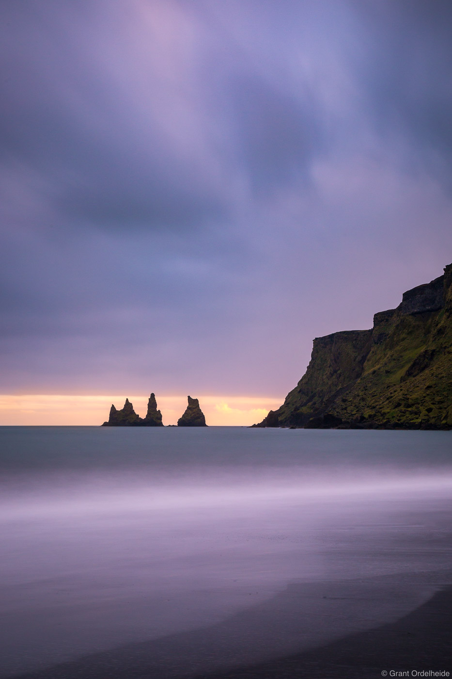 A stormy sunset from the beach along the small town of Vik on Iceland's southern coast.