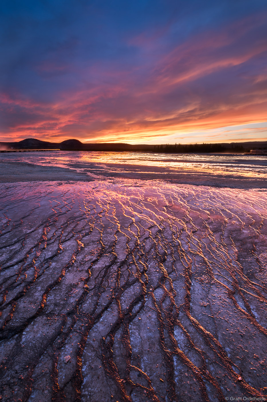 Sunset over the Grand Prismatic spring in Wyoming's Yellowstone National Park.