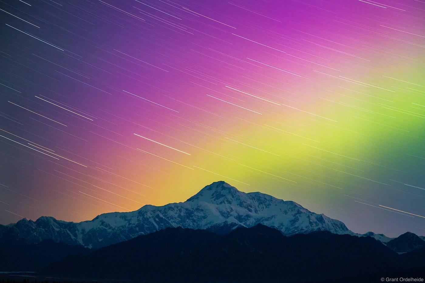 Star trails and aurora borealis over North America's tallest peak.