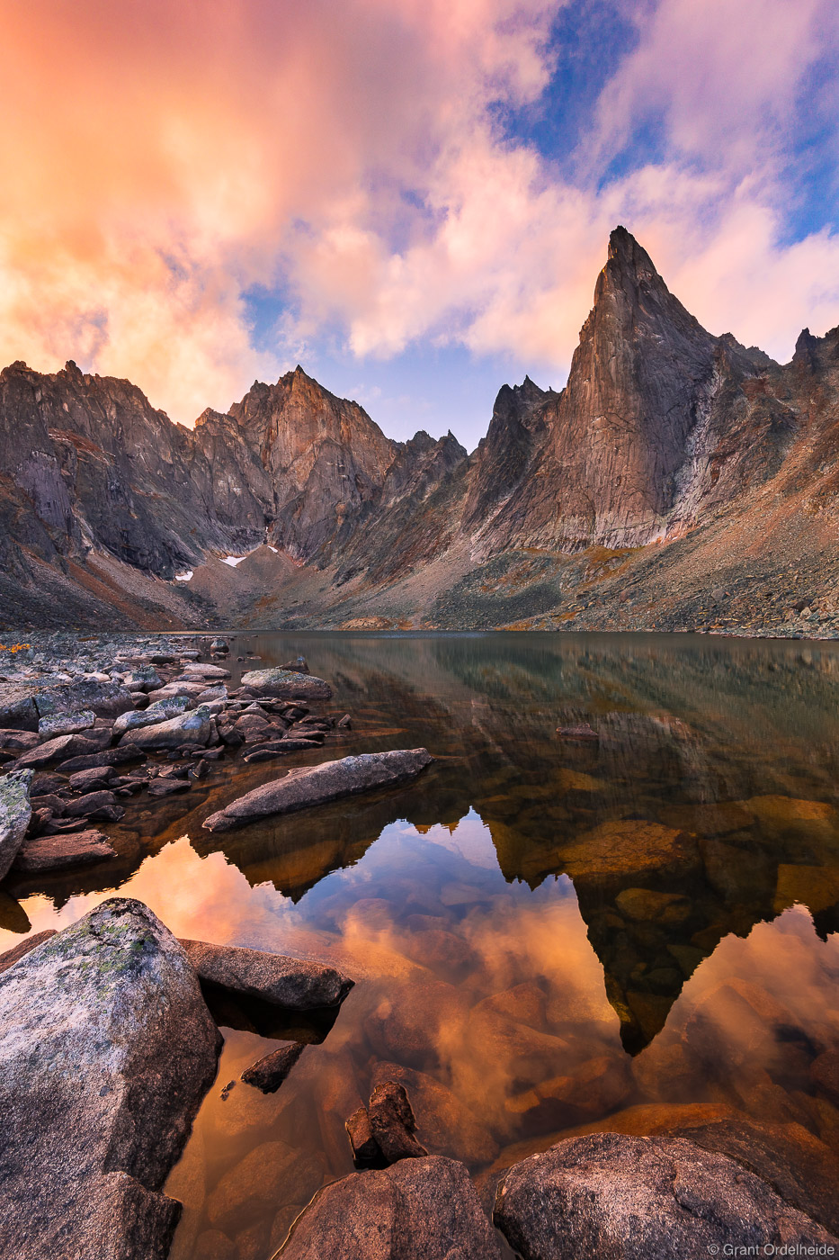 Sunset overa remote alpine lake in Canada's rugged Tombstone Territorial Park.