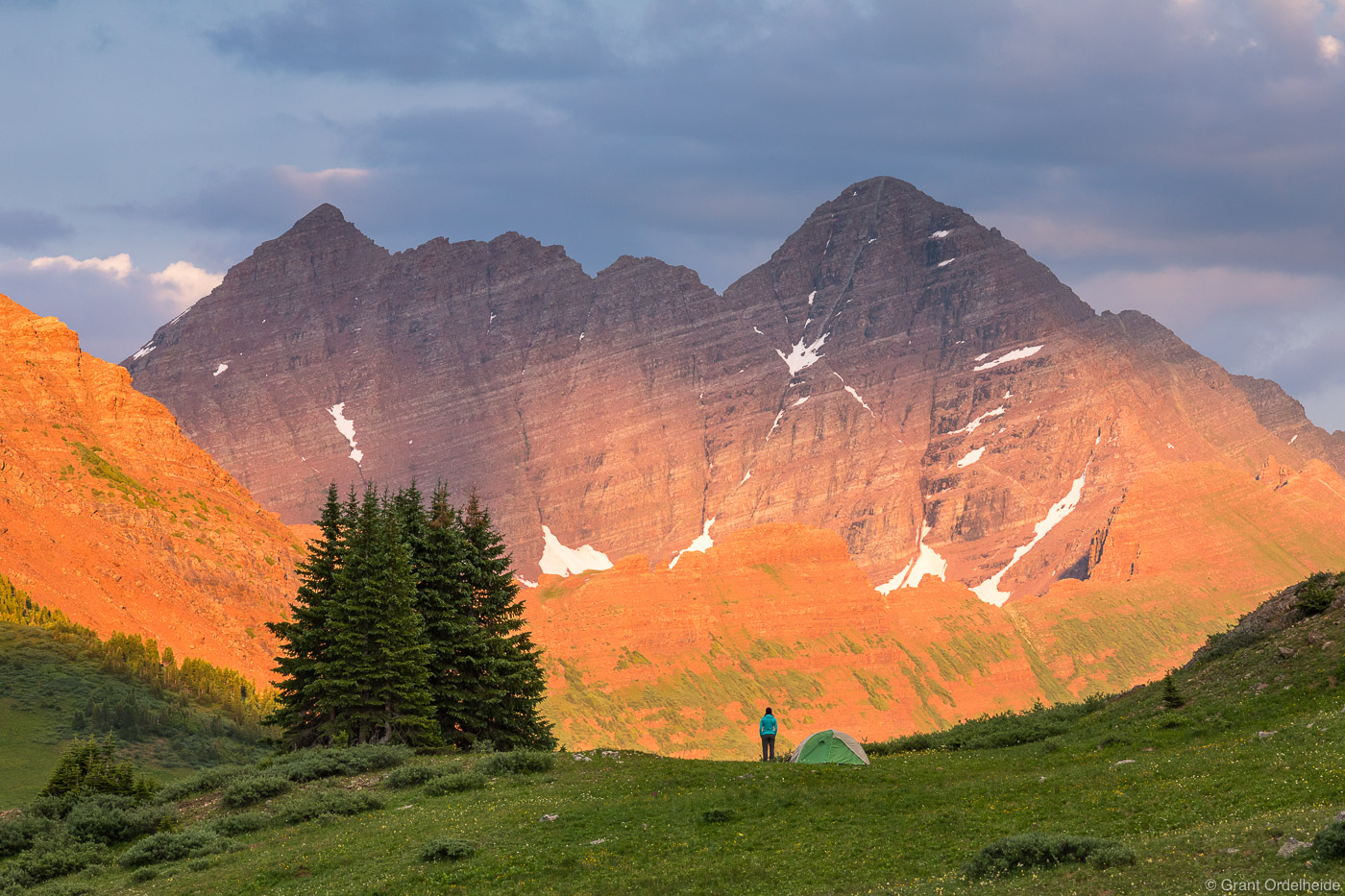A backpacker taking in sunset on the backside of the iconic Maroon Bells near Aspen Colorado.