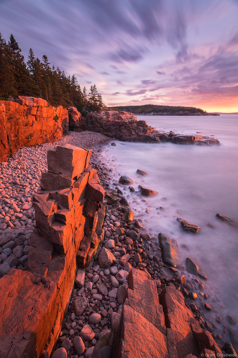 Sunrise over a rocky beach in Maine's Acadia National Park.