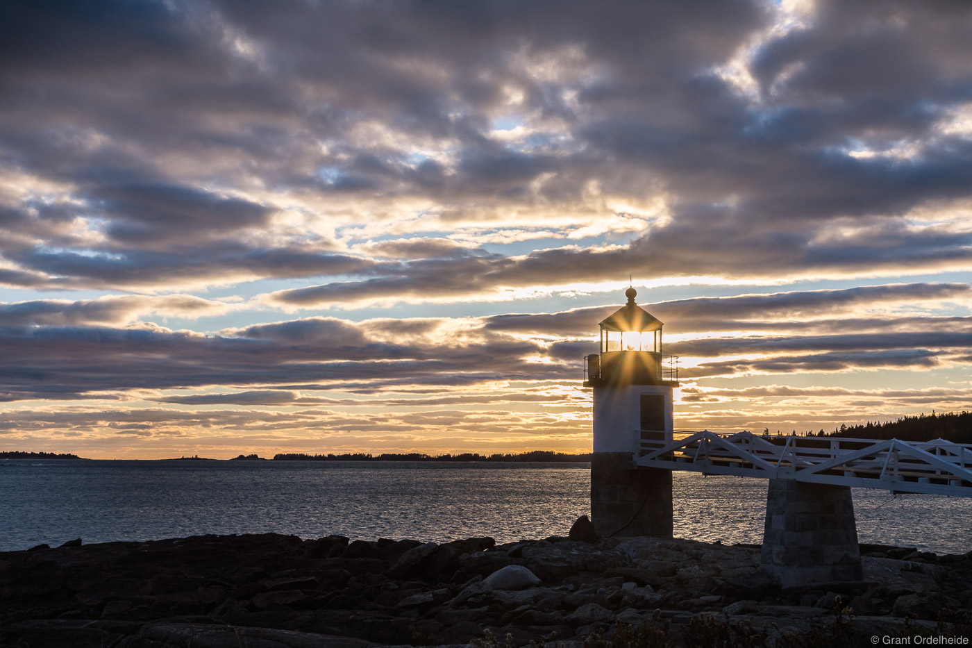 Sunset over the Marshall Point Lighthouse near Port Clyde, Maine.