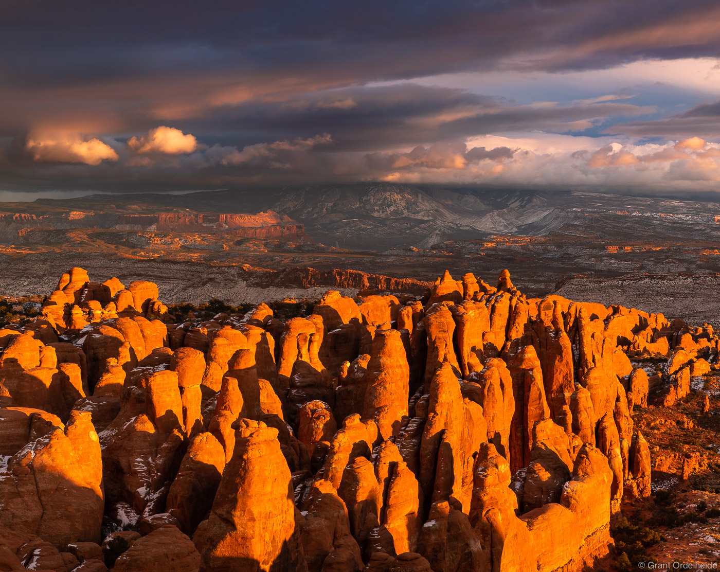 A dramatic winter sunset over the Fiery Furnace in Arches National Park.
