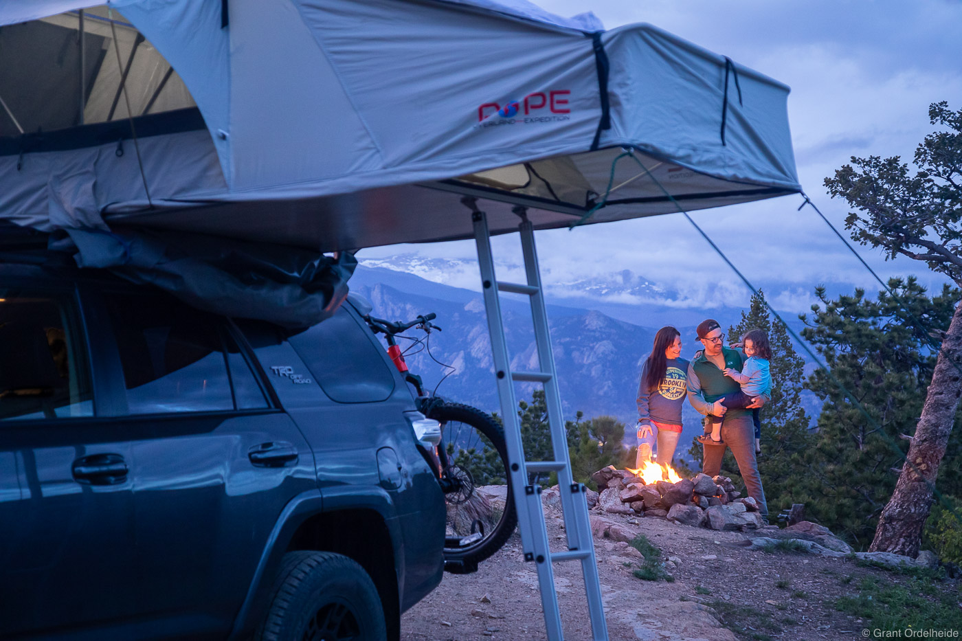 A family camping and enjoying a campfire on a cool Colorado evening.
