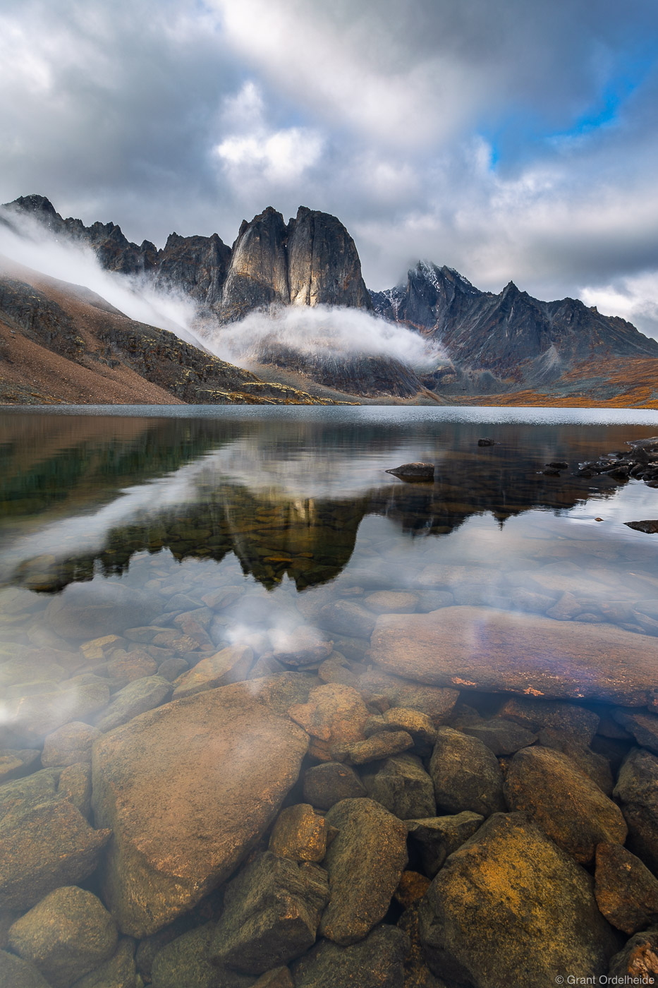 A serene autumn morning at Divide Lake in Canada's Tombstone Territorial Park.