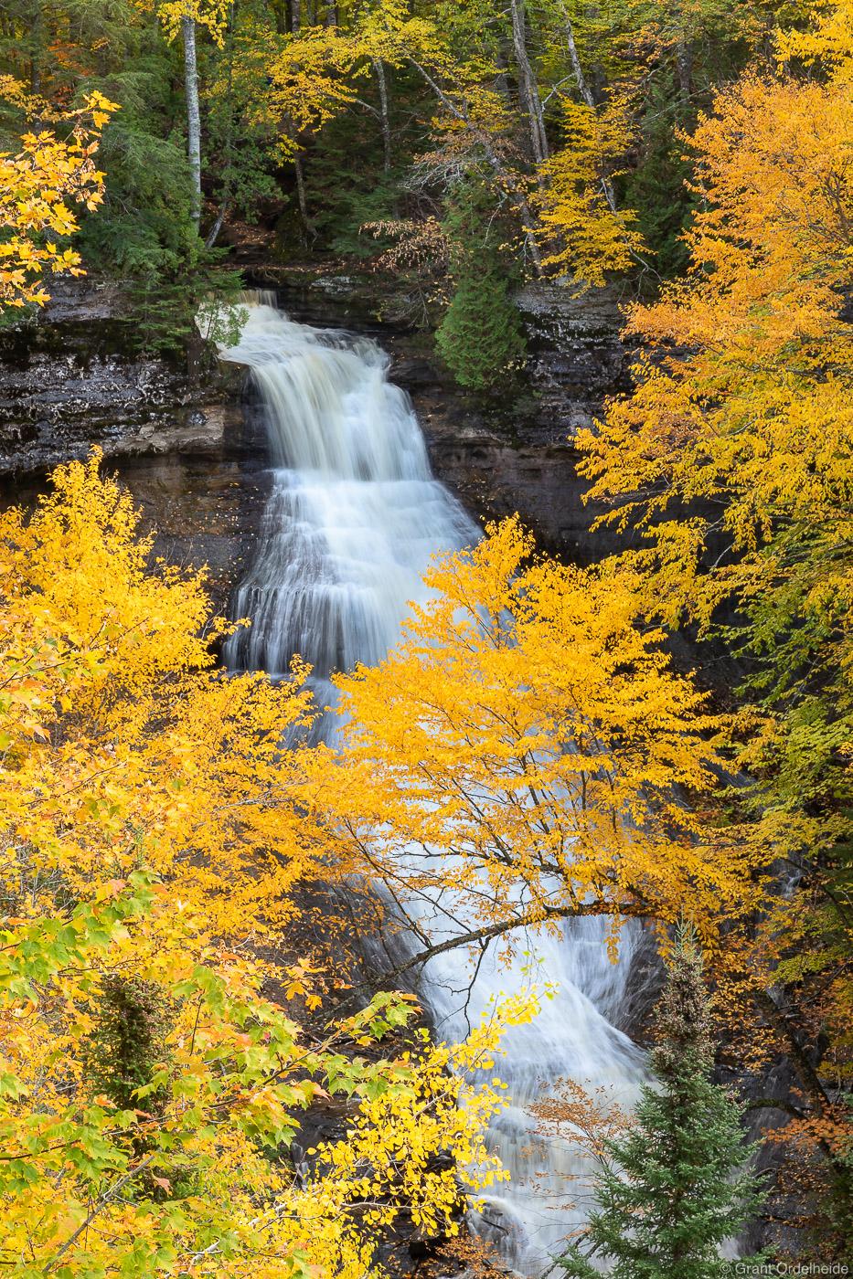 Vivid fall colors around Chapel Falls in Pictured Rocks National Lakeshore near Munising, Michigan.