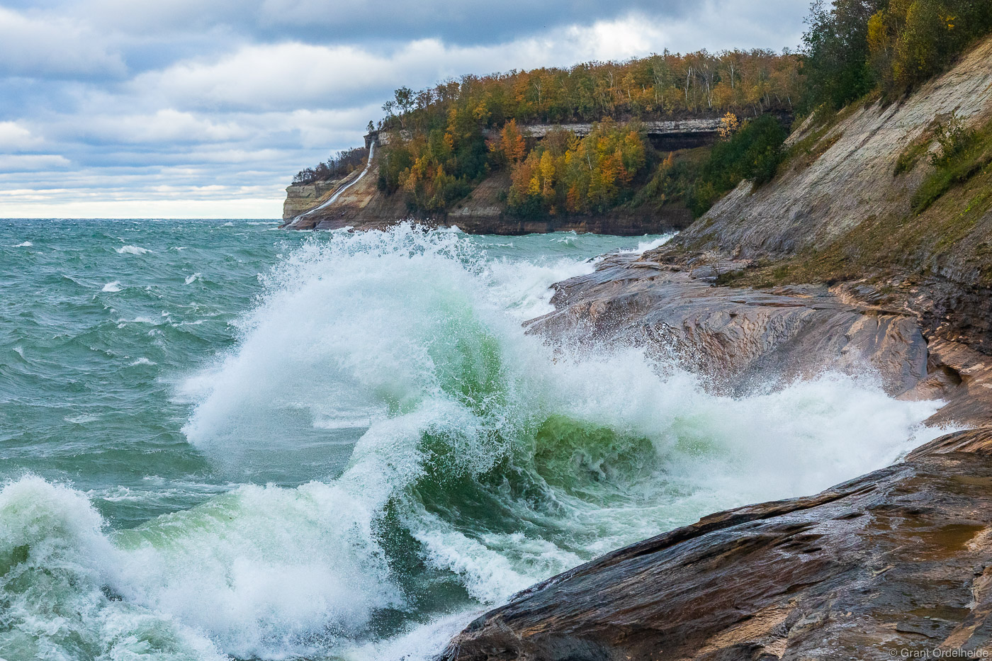 A wave crashing on the sandstone cliffs of Pictured Rocks National Lakeshore near Munising, Michigan.