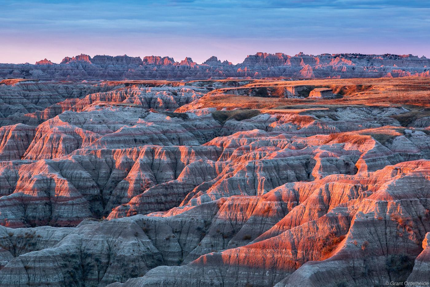 Sunrise over the arid landscape of South Dakota's Badlands National Park.