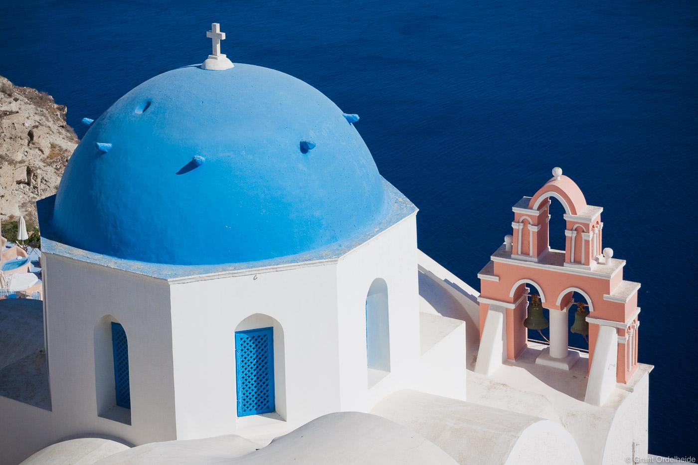 The classic Mediterranean architecture of Santorini overlooks the deep blue Mediterranean Sea.