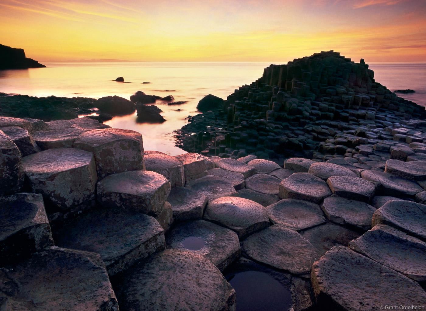 Sunset over the basalt columns of Giants Causeway in Northern Ireland