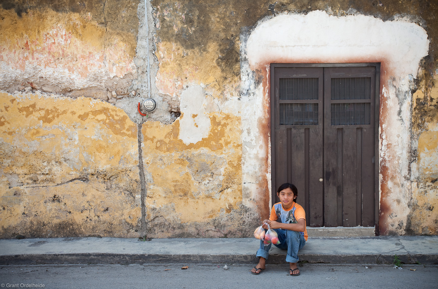 izamal, mexico, yucatan, young boy, old, decrepit, wall,, photo