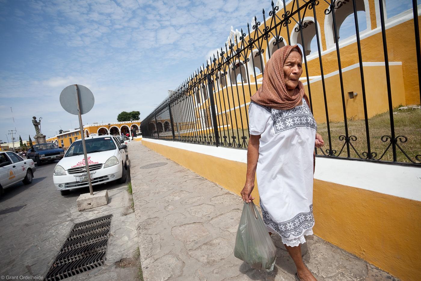 izamal, yucatan, mexico, woman, walks, sidewalk, yellow, city, photo